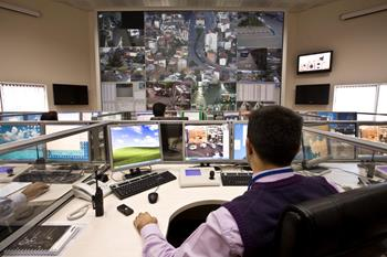 Operator in a police station monitoring a smart city