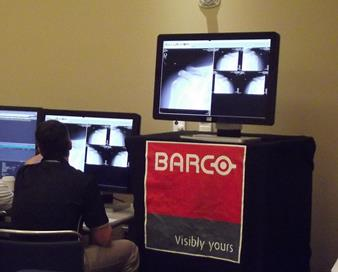 Scouting Combine trainers and physicians viewing athletes' images using Barco displays (2)