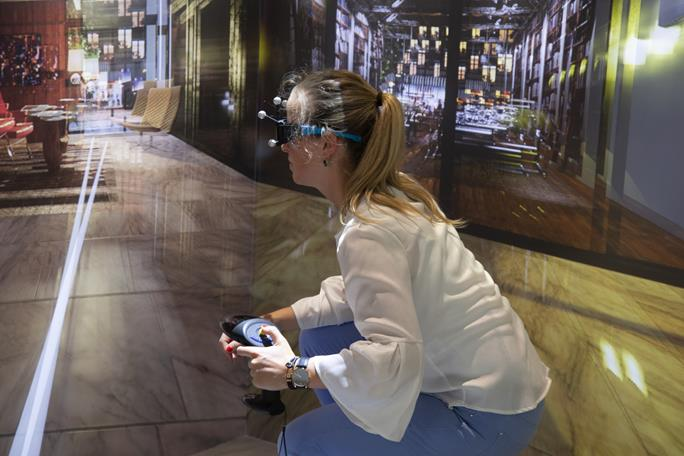 VR in construction - HMDs vs wide immersive environments (caves) - Barco